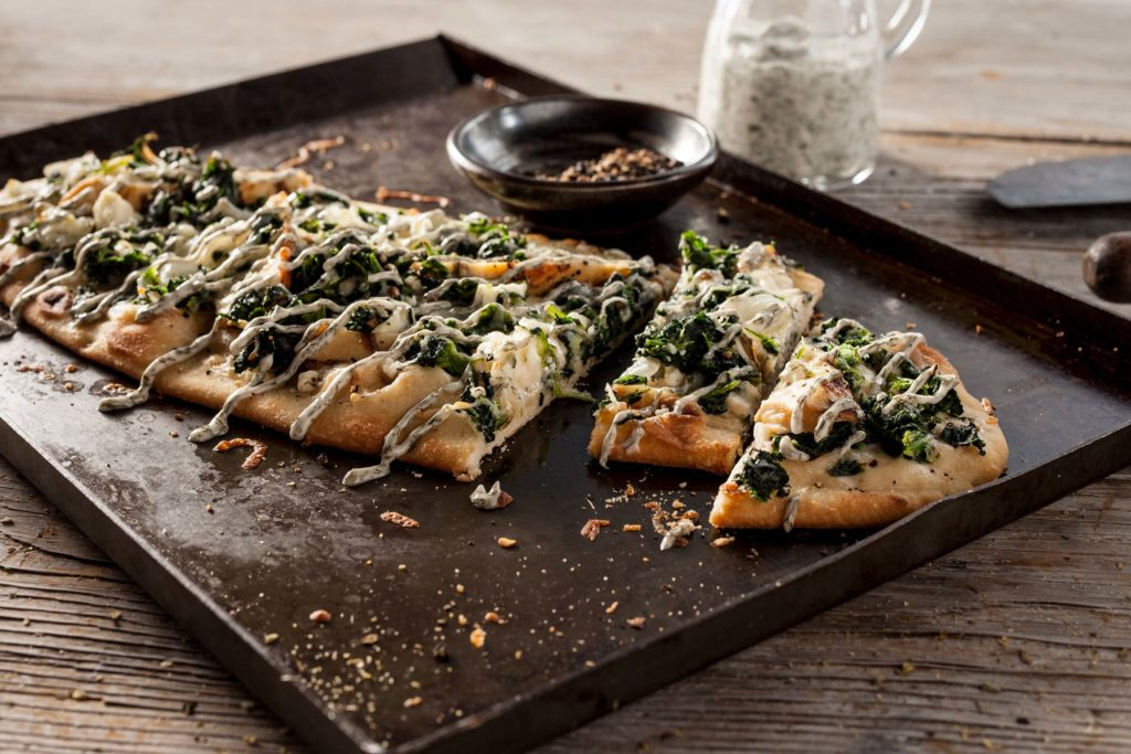 Chicken Spanakopita served on top of a Stonefire Oval Flatbread.